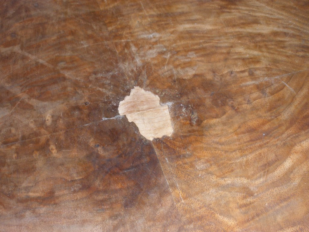 Deeply scratched surface of coffee table prior to restoration