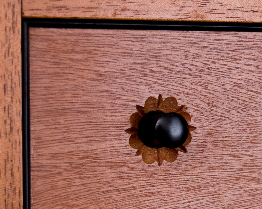 Drawer pull detailing on cabinet