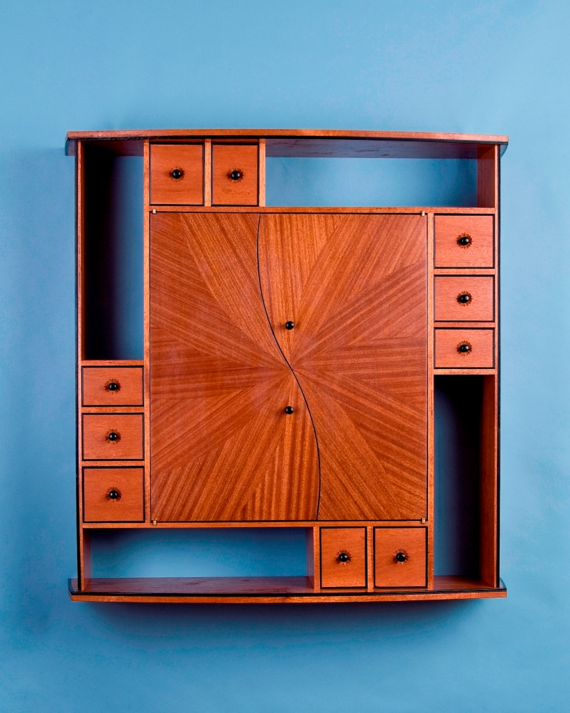Spiral curio cabinet for wall mounting